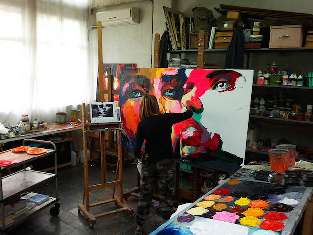 Artist Francoise Nielly painting in her studio